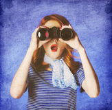 American redhead girl in suglasses with binocular Stock Photos