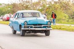 American retro car on the road, Vinales, Pinar del Rio, Cuba. Copy space for text.