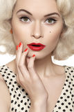 American retro. pin-up girl with old fashioned make-up, red nails manicure, blond hair Royalty Free Stock Photography