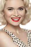 American retro style. Beautiful laughing woman model with old fashioned make-up, blond hair, happy smile Royalty Free Stock Images