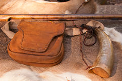 American Revolutionary War rifle and accessories. A vintage leather satchel, flintlock gun and powder horn from the war of independence Stock Photo