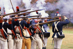 American Revolutionary War Soldiers. Continental soldiers firing rifles at American Revolutionary War re-enactment Royalty Free Stock Images