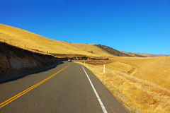 The American road in autumn hills Stock Image