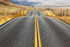 The American road and fencings Royalty Free Stock Images