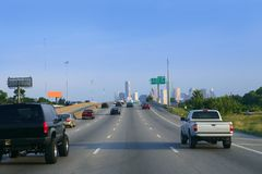 American road way to Houston city downtown. With car traffic Royalty Free Stock Photos
