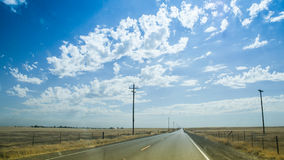 American roads. A lonely american road passing through the desert Royalty Free Stock Photos