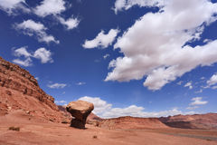 American rock desert and glowing clouds Royalty Free Stock Images