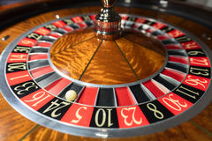American Roulette wheel with a ball. In the number `24 stock photography