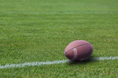 American rugby ball on the grass Royalty Free Stock Images