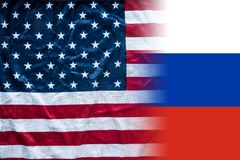 American and russian flag combined. An american flag with stars and stripes turning into a russian flag Royalty Free Stock Image