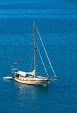 American Sailboat on Brilliant Blue Water Stock Image