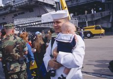 American Sailor Holding Baby After Returning Home From Sea Stock Photography