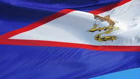 American Samoa flag in slow motion seamlessly looped with alpha. American Samoa flag waving in slow motion against blue sky, seamlessly looped, close up stock video
