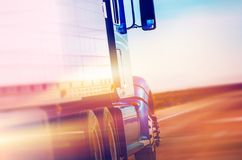 American Semi Truck. Speeding American Semi Truck on the Highway. American Transportation and Logistic Stock Image