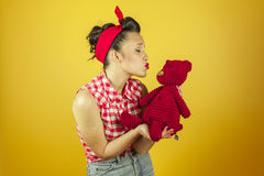 American shot portrait beautiful pin up with cute red teddy bear Stock Photography