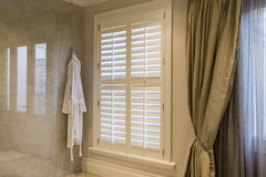 American Shutters in Bathroom Royalty Free Stock Photography