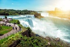 American side of Niagara falls, NY, USA. Tourists enjoying beautiful view to Niagara Falls during hot sunny summer day.  royalty free stock photos