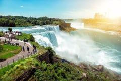 American side of Niagara falls, NY, USA. Tourists enjoying beautiful view to Niagara Falls during hot sunny summer day.  stock photos