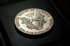 American silver dollar on black holder. Selective focus, closeup Royalty Free Stock Images