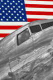 American Silver Flyer. This is a vintage silver airplane sitting below an American flag Royalty Free Stock Photos