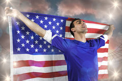 American soccer fan holding flag Royalty Free Stock Images