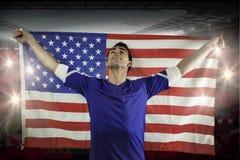American soccer fan holding flag Stock Image
