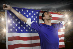American soccer fan holding flag Royalty Free Stock Photography