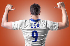 American soccer player on red background Stock Photo