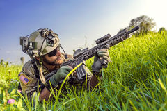 American Soldier aiming his rifle on blue sky background Royalty Free Stock Photos