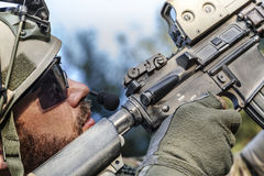 American Soldier aiming his rifle Stock Image