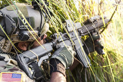 American Soldier aiming his rifle on the grass Stock Photography