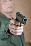 American soldier aiming pistol Royalty Free Stock Photos