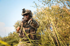 American soldier aiming rifle and pointing at you Royalty Free Stock Image