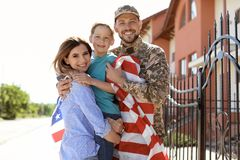 American soldier with family outdoors. Military service stock images