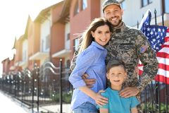 American soldier with family outdoors. Military service. American soldier with happy family outdoors. Military service stock image