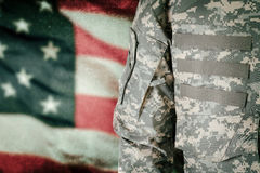 American soldier with flag on background Stock Photography