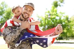 American soldier with his son outdoors stock images