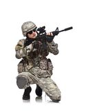 American soldier. Kneeling with rifle stock photo