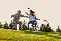 American soldier is meeting his two daughters outdoor. royalty free stock image