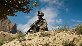 American soldier on patrol in Afghanistan II Stock Images