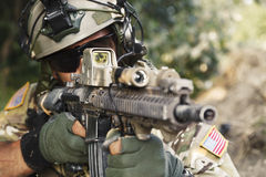 American soldier pointing his rifle. American soldier pointing hi rifle during the military operation Stock Images