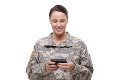 American soldier reading a text message Royalty Free Stock Images