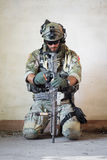 American soldier resting from military operation. Portrait of american soldier resting from military operation Stock Images
