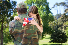 American soldier reunited with daughter. On a sunny day stock photography