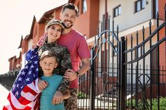 American soldier with her family outdoors. Military service royalty free stock photography