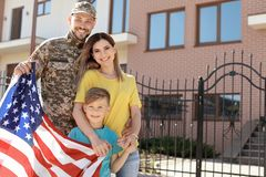 American soldier reunited with his family outdoors. Military service royalty free stock photos