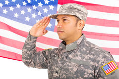 American soldier saluting. Portrait of american soldier saluting on us flag background stock photos