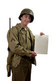 American soldier shows a sign Royalty Free Stock Photos
