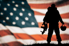American soldier silhouette. American soldier black silhouette with american flag Royalty Free Stock Image