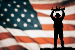 American soldier silhouette. American soldier black silhouette with american flag Royalty Free Stock Photography